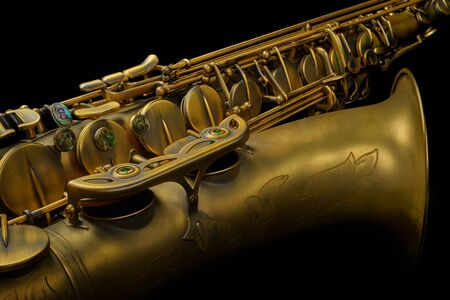 Close up studio shot of a tenor sax against pure black Stock Photo