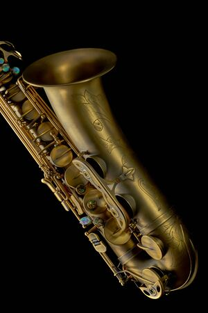 Tenor saxophone close-up on black