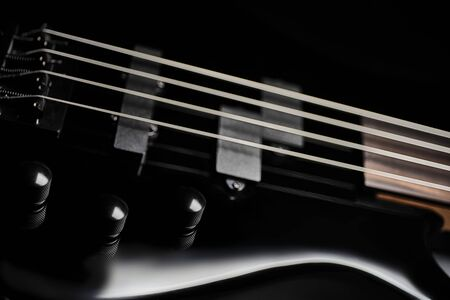 4 string bass guitar - black studio closeup