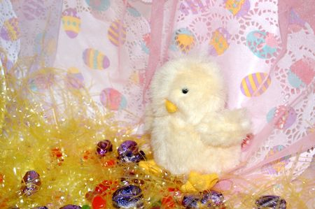 Toy chick with candies Archivio Fotografico