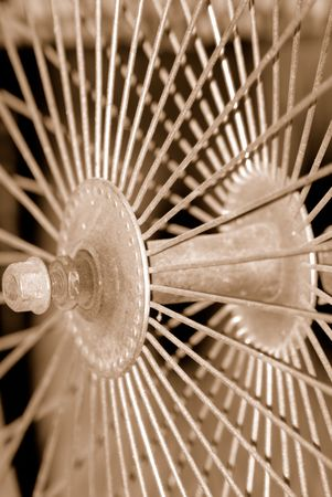 Sepia toned spokes of an old bicycle