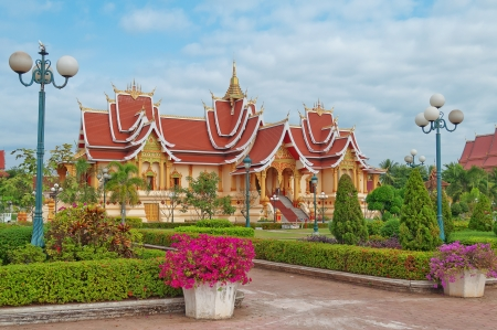 Temple next to Pha That Luang stupa in Vientiane  Laos  photo