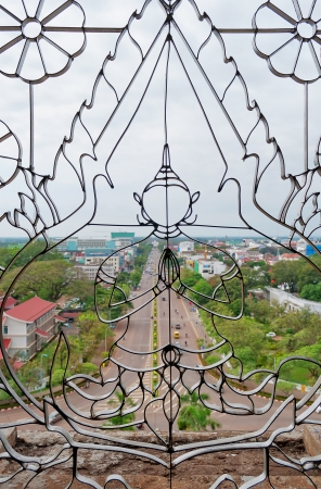 french ethnicity:  View of Vientiane from Patuxay Window with an image of Buddha  Laos