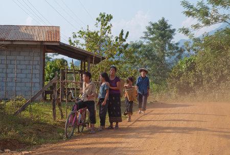Lao people on a rural road. Vang Vieng. Laos. Stock Photo - 18369036