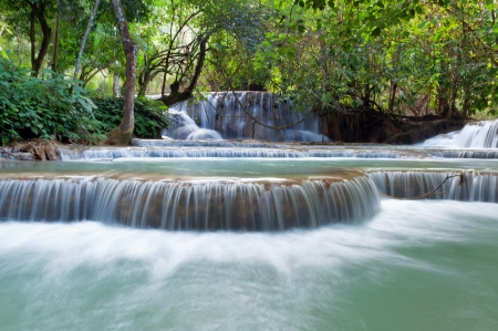 The Kuang Si Falls, sometimes spelled Kuang Xi, is a three tier waterfall about 29 kilometres  18 mi  south of Luang Prabang in Laos  photo
