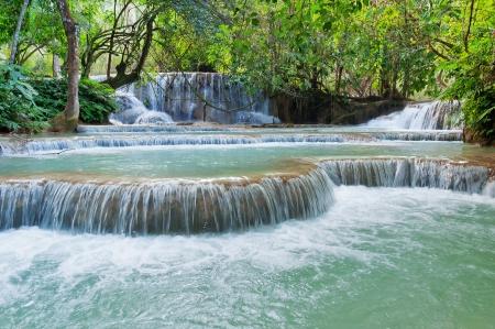 kilometres: The Kuang Si Falls, sometimes spelled Kuang Xi, is a three tier waterfall about 29 kilometres  18 mi  south of Luang Prabang in Laos