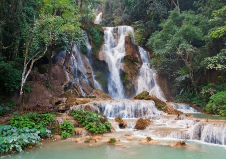 The Kuang Si Falls, sometimes spelled Kuang Xi, is a three tier waterfall about 29 kilometres  18 mi  south of Luang Prabang in Laos