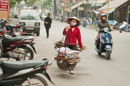 Woman Carrying Baskets on the street in Hanoi. Vietnam.