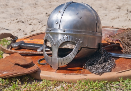 Viking weaponry  Sword, shield and helmet at a historical reenactment festival held in Abalak, Siberia  Russia  photo