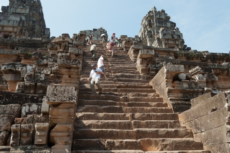 SIEM REAP, CAMBODIA - DEC 26  Tourists climb to Ta Keo temple on Dec 26, 2012, in Siem Reap, Cambodia  Ta Keo is a temple-mountain in Angkor