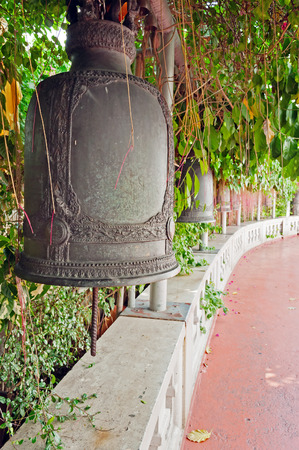 Old bells hanging along the stairway of the Golden mountain temple (Phu Khao Thong) in Bangkok. Thailand photo