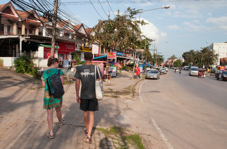 aonang: AO NANG, THAILAND - DEC 9: : Tourists walk on the street in Ao Nang on December 9, 2013, in Ao Nang, Thailand. Ao Nang is a small resort town and subdistrict in the Mueang Krabi District of Krabi Province