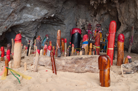 resides: Wooden phalluses in Princess cave (Pranang cave). South Railay beach in Krab. Thailand. It is believed among villagers the here that the spirit of Pranang (Princess Goddess) resides in this cave Stock Photo