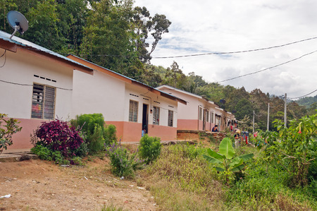 orang: CAMERON HIGHLANDS, MALAYSIA - DEC 14, 2013: Aborigine Village (Orang Asli). Orang Asli is  indigenous people of Peninsular Malaysia. Officially, there are 18 Orang Asli tribes. Government built houses for them  Editorial