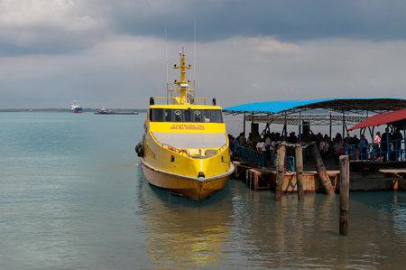 regionally: DUMAI, INDONESIA - DEC 21, 2013: Ferry Melaka-Dumai in Dumai Port. Dumai is an important transport and trade centre, both regionally and internationally