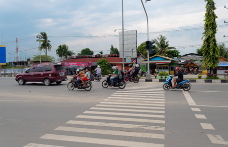 internationally: DUMAI, INDONESIA - DEC 21, 2013: On the street in Dumai. Dumai is an important transport and trade centre, both regionally and internationally