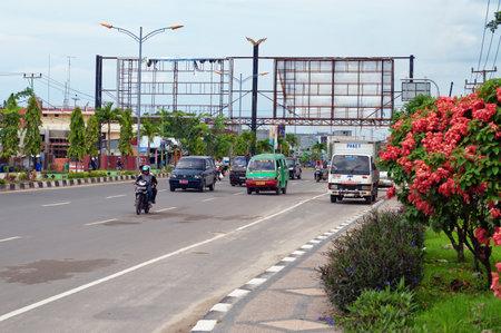 regionally: DUMAI, INDONESIA - DEC 21, 2013: On the street in Dumai. Dumai is an important transport and trade centre, both regionally and internationally