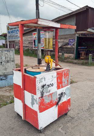 internationally: DUMAI, INDONESIA - DEC 21, 2013: Gas station on the street. Dumai is an important transport and trade centre, both regionally and internationally