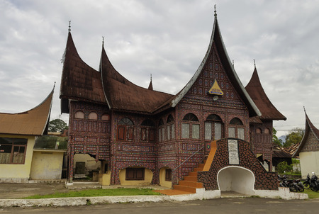 BUKITTINGGI, INDONESIA - DEC 22, 2013: Minangkabau traditional hous.  Bukittinggi is the second biggest city in West Sumatra. It is located near the volcanoes Mount Singgalang and Mount Marapi Editorial