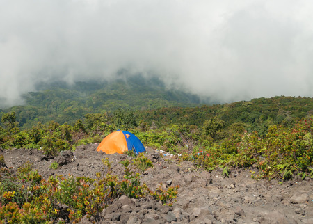 Tent on the mountain in fog and clouds. Volcano Mount Merapi. West Sumatra. Indonesia photo