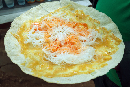 Indonesian snack, rice cake with noodles and spicy sauce on the street market photo