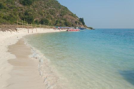 rin: PATTAYA, THAILAND - JAN 05, 2014: Tourists on the beach of island Koh Rin. Koh Rin is uninhabited wild island with the most beautiful white sand beach. Editorial