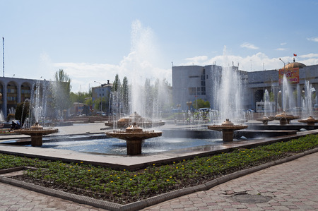 BISHKEK, KYRGYZSTAN - MAY 02, 2014:  Fountain on Ala-Too Square. Bishkek formerly  Frunze, is the capital and the largest city of the Kyrgyz Republic.  The population - 900,000 people