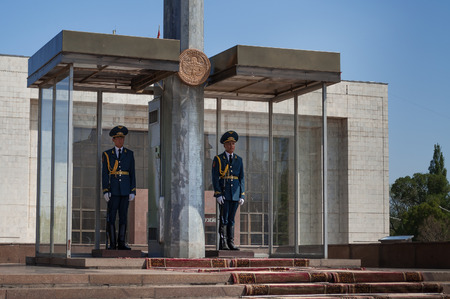 kyrgyz republic: BISHKEK, KYRGYZSTAN - MAY 02, 2014:  Two guards soldiers on Ala-Too Square. Bishkek formerly  Frunze, is the capital and the largest city of the Kyrgyz Republic.  The population - 900,000 people