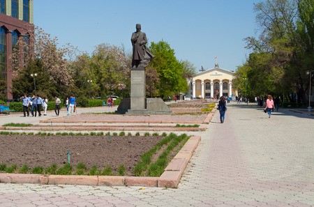 kyrgyz republic: BISHKEK, KYRGYZSTAN - MAY 02, 2014: Monument to Shabdan Baatyr (Shabdan Djantaev) and Kyrgyz National University named Zhusup Balasagyn. Bishkek formerly  Frunze, is the capital and the largest city of the Kyrgyz Republic.  The population - 900,000 people