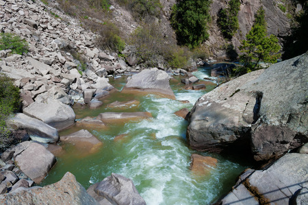 ata: River in Grigorevsky gorge. Grigorevsky gorge (Chon-Ak-Suu gorge) is situated in 60 kilometers from Cholpon-Ata city. Grigorevsky gorge is considered one of the most picturesque gorges in Issyk Kul area. Stock Photo