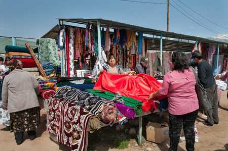 issyk kul: BOSTERI, KYRGYZSTAN - MAY 4, 2014: Sunday market. Bosteri is a village in the Issyk Kul Province of Kyrgyzstan. It is a popular resort village where a lot of hotels, resort Editorial