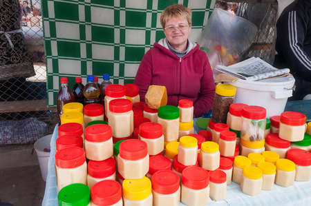 issyk kul: BOSTERI, KYRGYZSTAN - MAY 4, 2014: Honey on Sunday market. Bosteri is a village in the Issyk Kul Province of Kyrgyzstan. It is a popular resort village where a lot of hotels, resort Editorial