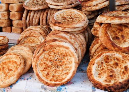 sunday market: Tokoch pan kirguises en mercado de los domingos en Bosteri. Issyk-Kul. Kirguist�n.