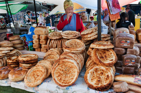 BOSTERI, KYRGYZSTAN - MAY 4, 2014: Kirghiz bread tokoch on Sunday market. Bosteri is a village in the Issyk Kul Province of Kyrgyzstan. It is a popular resort village where a lot of hotels, resort Editorial