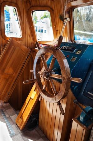 Wooden steering wheel at yacht photo