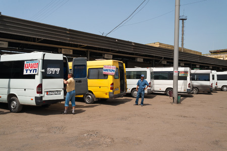 kyrgyz republic: BISHKEK, KYRGYZSTAN - MAY 5, 2014: Minibuses in Bus Terminal West. Bishkek formerly Frunze, is the capital and the largest city of the Kyrgyz Republic. The population - 900,000 people