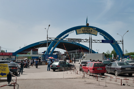 shortest: KORDAY, KAZAKHSTAN - MAY 5, 2014: Border entry to Kazakhstan from Kyrgyzstan. This border checkpoint is one of the most important on the border between Kazakhstan and Kyrgyzstan, as there is the shortest road from Bishkek to Almaty (Highway M 39)