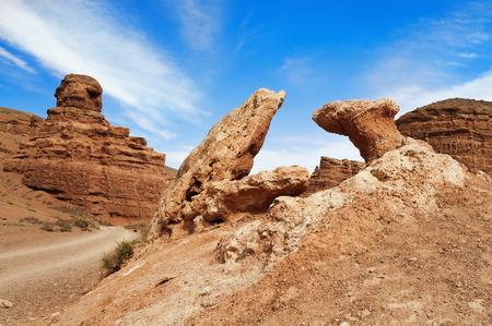 kilometres: Valley of Castles in Sharyn Canyon.  Sharyn Canyon is an 80 km canyon on the Sharyn River, 200 kilometres east of Almaty. Kazakhstan