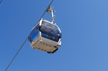 cableway: ALMATY, KAZAKHSTAN - MAY 8, 2014: Cabin on Ski lifts to Shymbulak ski resort. It is located in the upper part of the Medeu Valley in the Zaiilisky Alatau mountain range, at the elevation of 2200 meters above sea level. Editorial