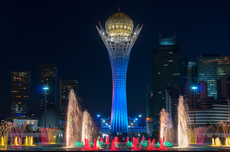 ASTANA, KAZAKHSTAN - MAY 9, 2014: Bayterek Tower and  fountain show at night. Bayterek is a monument and observation tower in Astana. The height of buildings 105 meters