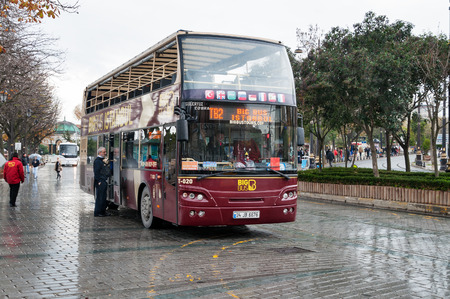 sight seeing: ISTANBUL, TURKEY, DEC 4, 2014:  Sight seeing tourist bus BigBus on Sultanahmet Square in winter in rainy weather. The Big Bus sightseeing tour is well way to discover this great city