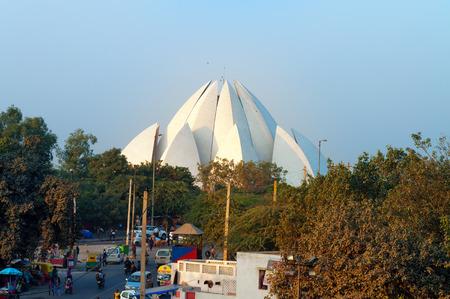 the house of worship: NEW DELHI, INDIA, DEC - 5, 2014: View of Lotus Temple (Bahai House of Worship) from metro station. The Temple is visited by over four million people annually. It is located on Bahapur Hills