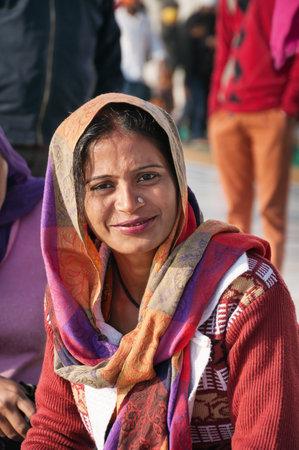 holiest: AMRITSAR, INDIA, DEC - 7, 2014: Unidentified woman  in Golden Temple (Harmandir Sahib also Darbar Sahib). Golden Temple is the holiest Sikh gurdwara located in the city of Amritsar, Punjab, India. Editorial