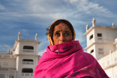 AMRITSAR, INDIA, DEC - 7, 2014: Unidentified woman  in Golden Temple (Harmandir Sahib also Darbar Sahib). Golden Temple is the holiest Sikh gurdwara located in the city of Amritsar, Punjab, India. Editorial