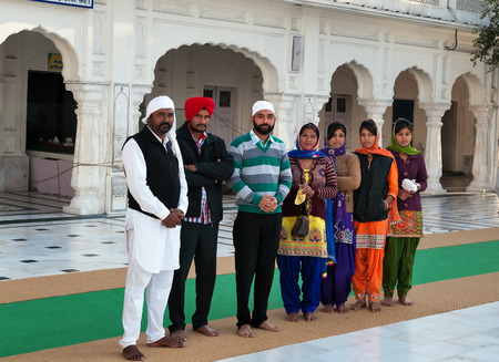 harmandir sahib: AMRITSAR, INDIA, DEC - 7, 2014: Unidentified group of Indian people in Golden Temple (Harmandir Sahib also Darbar Sahib). Golden Temple is the holiest Sikh gurdwara located in the city of Amritsar, Punjab, India. Stock Photo