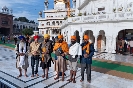 AMRITSAR, INDIA, DEC - 7, 2014: Unidentified group of Indian Sikh men in Golden Temple (Harmandir Sahib also Darbar Sahib). Golden Temple is the holiest Sikh gurdwara located in the city of Amritsar, Punjab, India.