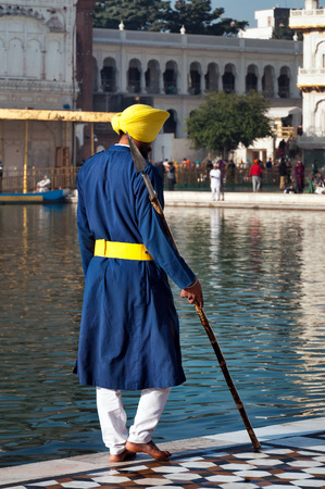 harmandir sahib: AMRITSAR, INDIA, DEC - 7, 2014: Unidentified Sikh guard at Golden Temple (Harmandir Sahib also Darbar Sahib). Golden Temple is the holiest Sikh gurdwara located in the city of Amritsar, Punjab, India.