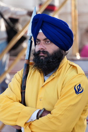 AMRITSAR, INDIA, DEC - 7, 2014: Unidentified Sikh guard at Golden Temple (Harmandir Sahib also Darbar Sahib). Golden Temple is the holiest Sikh gurdwara located in the city of Amritsar, Punjab, India.