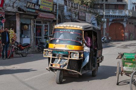auto rickshaw: AMRITSAR, INDIA, DEC - 7, 2014:  Auto rickshaw or tuk-tuk on the street. Auto rickshaws are a common means of public transportation in India