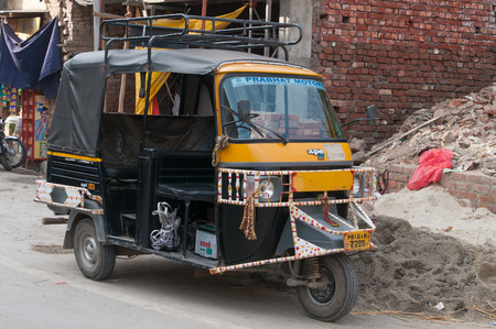 auto rickshaw: AMRITSAR, INDIA, DEC - 7, 2014:  Auto rickshaw or tuk-tuk on the street. Auto rickshaws are a common means of public transportation in India